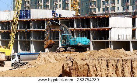 Construction Site Background.cranes , Excavator, Dump Truck, Builders On The Construction Site.