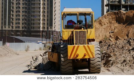 Road Roller At The Construction Site. Construction Site Background.