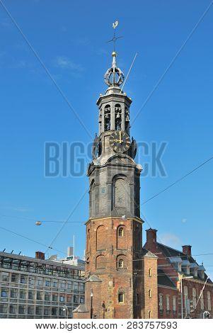 Amsterdam, Netherlands. Ancient Tower Munttoren In A Sunny Summer Day