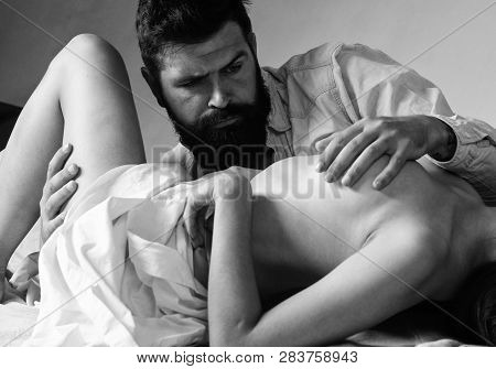 Lover And Sexy Naked Female Body Foreplay In Bed. Couple Make Love Have Sex. Man With Beard Sexual F