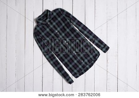 Fashion Clothes. Green Checkered Shirt On White Wooden Floor Planks