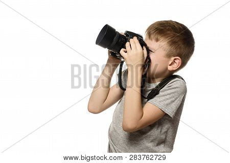 Boy Takes Pictures On The Camera. Portrait. Isolate On White Background. Side View.
