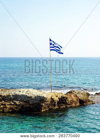 Greek Flag On A Small Rocky Island. Greece