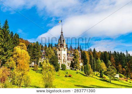 Peles castle Sinaia in summer season, Transylvania, Romania protected by Unesco World Heritage Site poster