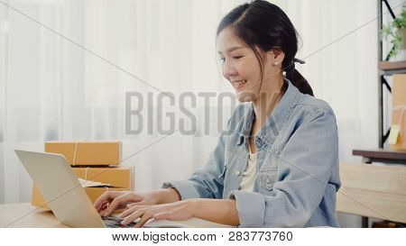 Beautiful Smart Asian Young Entrepreneur Business Woman Owner Of Sme Online Checking Product On Stoc