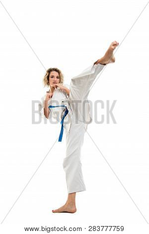Full Body Of Woman Making Martial Arts Kicking Up Wearing White Outfit