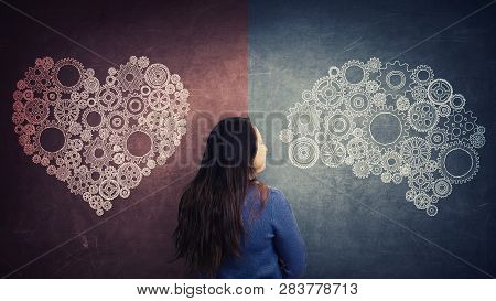 Rear View Woman And Split Blackboard With Heart And Brain Symbol On Different Sides. Difficult Decis