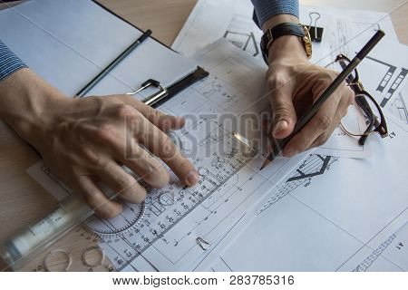 Architect's Desktop. Plan Of House. Architect Workplace. Architect Is Working With Drawings. Office