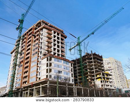 Construction Site Background. Commerxial Construction Project. Two Cranes Near Building Under Constr