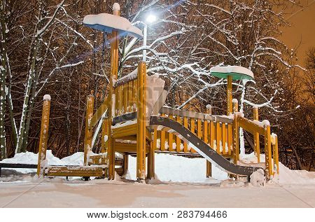 Playground In The City Park In The Winter Night