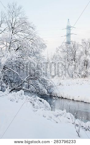 River And Power Line On A Winter Day