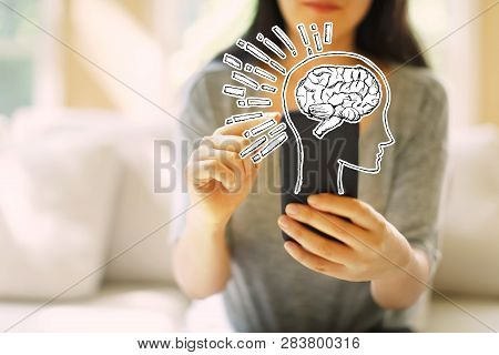 Brain Illustration With Woman Using Her Smartphone In A Living Room