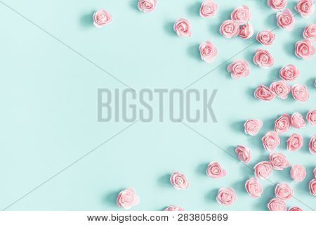 Flowers Composition. Pink Rose Flowers On Pastel Blue Background. Valentines Day, Mothers Day, Women