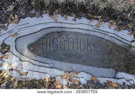 Natural background of frozen puddle on the plateau above Demir Baba Teke, cult monument honored by both Christians and Muslims in winter near Sveshtari village, Isperih, Razgrad District, Northeastern Bulgaria poster