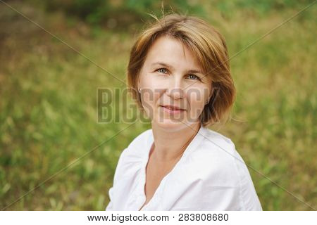 Ordinary Woman Outdoors In The Summer Time