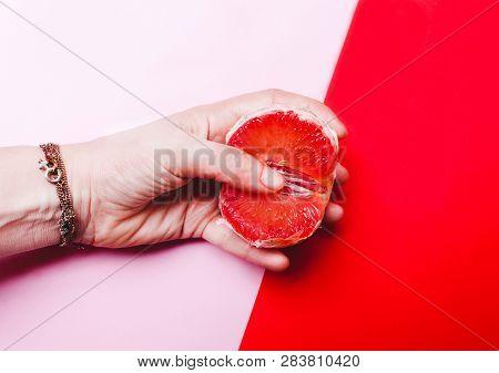 Concept Sex, Masturbation. Hand, Fingers In Grapefruit, Vagina Symbol