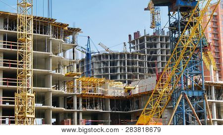 Industrial Background. Hoisting Cranes And Building Activity. Construction Site Background. Work On