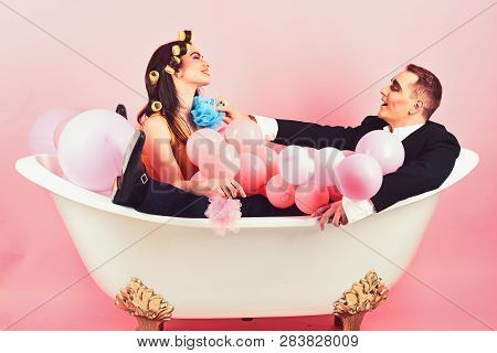 Your Hair Care Routine. Couple Of Mime Man And Sexy Woman Enjoy Bathing. Couple In Love In Bath Tub.