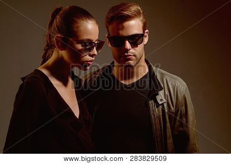 Falling In Love. Couple Of Man And Woman Wear Fashion Glasses. Fashion Models In Trendy Sun Glasses.