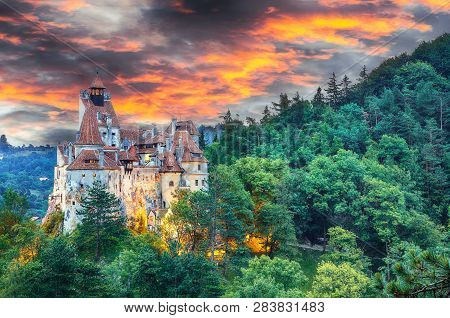 Landscape With Medieval Bran Castle Known For The Myth Of Dracula At Sunset, Brasov Landmark, Transy