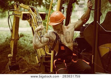 Workman Concept. Workman Flex Biceps And Triceps Muscle. Strong Workman At Excavator Cabin. Workman