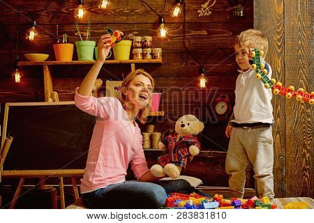 Daycare Concept. Little Child Play Daycare Game With Woman. Daycare Preschool. Family Daycare. Fun P