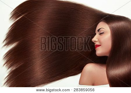 poster of Beautiful Hair. Beauty woman with luxurious long hair as background. Beauty Model Girl with Healthy brown Hair. Pretty female with long smooth shiny straight hair. Hairstyle. Keratin straightening.
