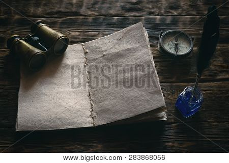 Blank Traveler Notebook, Binoculars And Nautical Compass On A Wooden Table Background Mockup. Advent