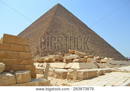 Bottom View Of The Ancient Stones And The Great Pyramid Of Cheops In Giza.