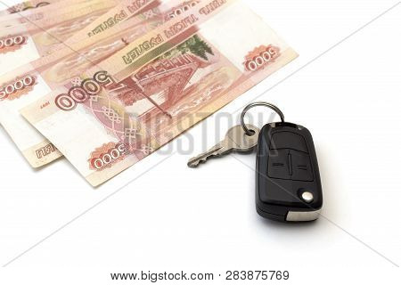 Isolated Black Car Key And A Bunch Of Banknotes Of Five Thousand Russian Rubles. Concept Of Purchase