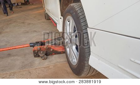 Removing Car Mechanic To Repair The Leaky Tire Car Wheels, Because Of The Exposed Screw Drill.