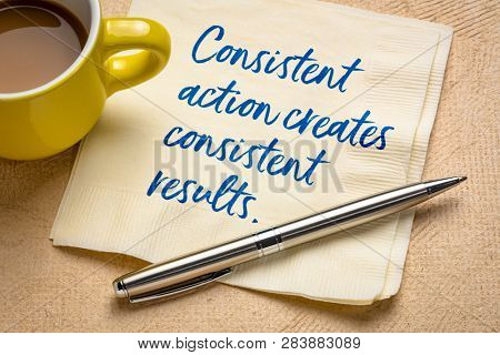 Consistent action creates consistent results - handwriting on a napkin with a cup of coffee poster