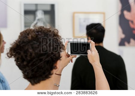 People attending an art exhibition