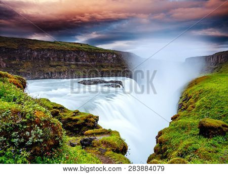 Dramatic view of the powerful Gullfoss waterfall (Golden Falls). One of most iconic and beloved waterfalls. Location place canyon of the Hvita river, Iceland, Europe. Discover the beauty of earth.