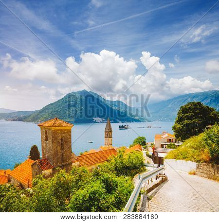 Wonderful scene of famous Kotor bay (Boka Kotorska) and St. Nikola Church. Location place Perast, Montenegro, Adriatic sea, Europe. Scenic image of tourist destination. Discover the beauty of earth.