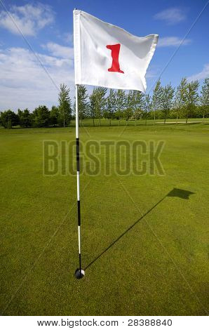 Closeup of golf flag number one
