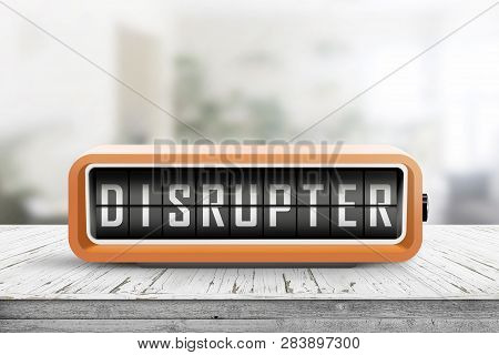 Disrupter Alarm On A Wooden Table In A Bright Room With Green Plants In The Background