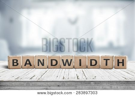 Bandwidth sign in a living room on a wooden desk in bright daylight poster