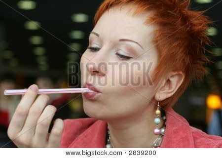 Woman Is Licking A Tubule In Cafe And Smiling Happy
