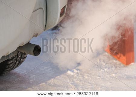 The Car Smokes In The Winter. Smoke From A Car Pipe. The Car Is Buzzing In The Cold.
