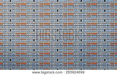Architectural Pattern, Window Facade With Orange Shutters Of A Skyscraper