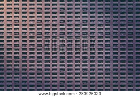 Architectural Pattern, Dark Concrete Facade With Balconies Of A Miserable House