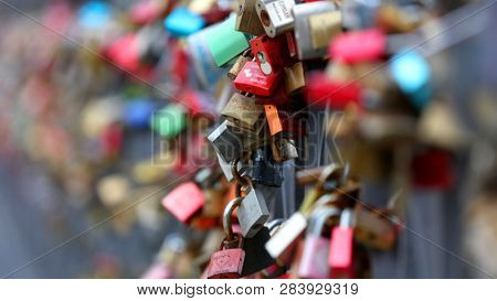 FRANKFURT AM MAIN, GERMANY - Mar 17, 2018: Love locks at famous Eiserner steg over the river Main. The Eiserner Steg is a pedestrian bridge only built in 1868.