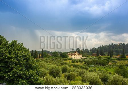 Beautiful View Of The Tuscany Fields From The Top Of The Hill At Boboli Garden. Rainy Cloudy Clouds