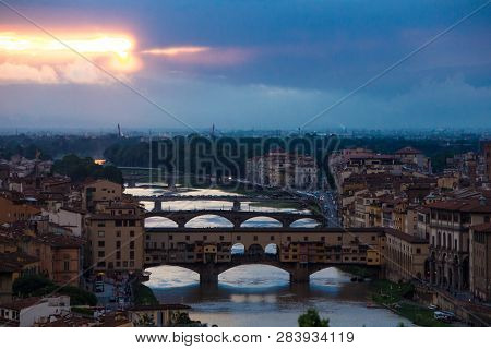 River Arno With Bridge Ponte Vecchio In The Evening View From Piazzale Michelangelo. Dramatic Sunset