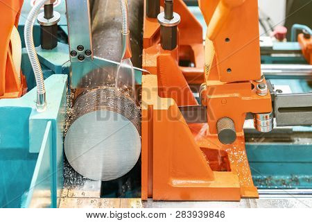 Round shaft steel is being cutting by automatic continuous and high speed horizontal band saw machine for industrial with the coolant fluid poster
