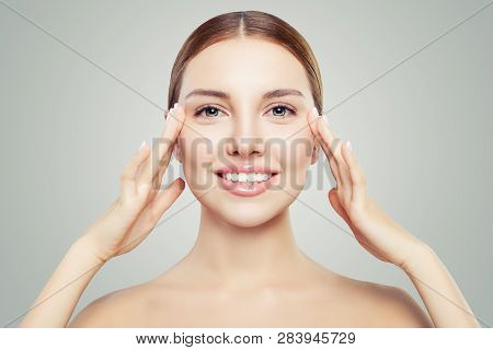 Beautiful Woman Touching Her Face In Eyes Area. Facial Treatment, Face Lifting, Anti Aging And Skin