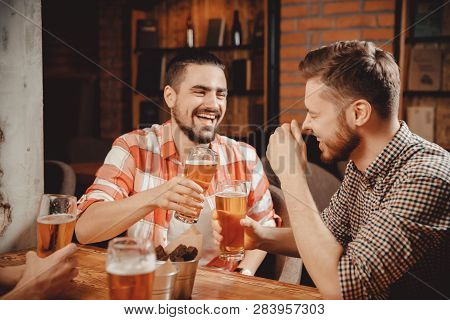 Two Bearded Young Men Plaid Shirts Relax Bar, Laugh, Tell Funny Stories, Drink Draught Beer In Pub,