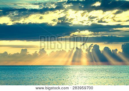 Beautiful Sea Landscape With A Sunset. Evening Sky With Clouds And Sunshine Over Ocean. Sun Rays Shi