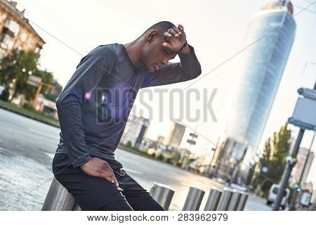 Need A Break. Tired African Athlete Touching Forehead And Resting During Urban Outdoor Workout